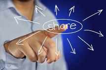 male businessman pointing finger to click share icon on virtual display